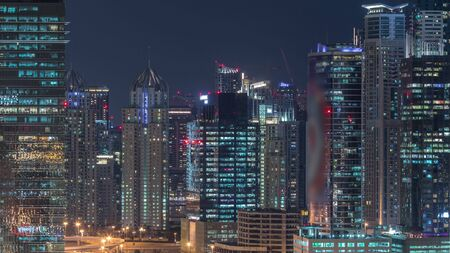 Dubai Marina and JLT aerial night timelapse top view of skyscrapers in Dubai, UAE. Modern towers and traffic on streets Stock fotó