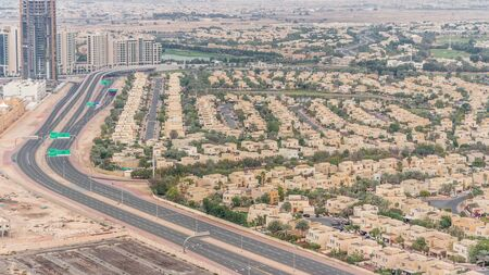 Aerial view of apartment houses and villas in Dubai city timelapse near jumeirah lake towers district, United Arab Emirates. Top fiew from skyscraper Stock fotó