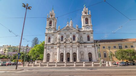 Front view on the Basilica da Estrela from the streets of Lisbon timelapse hyperlapse, Portugal. Traffic on the street and blue sky Stock Photo