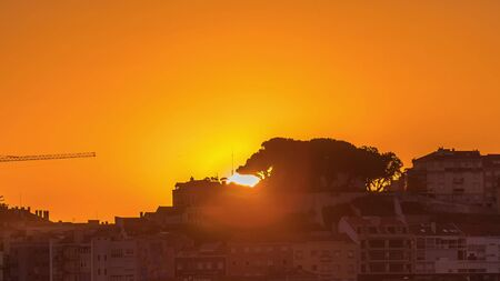 Sunrise over Lisbon aerial cityscape skyline timelapse from viewpoint of St. Peter of Alcantara, Portugal. Historical buildings from above at morning Stock Photo