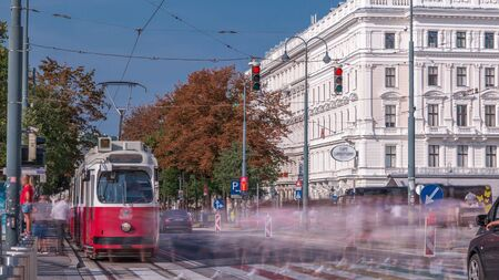 Rush Hour Traffic On Universitatsring Street Downtown Of Vienna City timelapse. Tram stop and crosswalk on a road