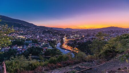 City view of Sarajevo with river from most popular panoramic spot in Sarajevo day to night transition timelapse. Road near Yellow Fortress (Zuta Tabija), Vratnik