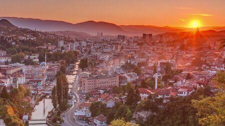 Sunset view of Sarajevo with river from most popular panoramic spot in Sarajevo timelapse. Road near Yellow Fortress (Zuta Tabija), Vratnik Banco de Imagens