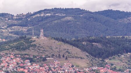 City panorama with houses and mountains from Old Jewish cemetery timelapse in Sarajevo. Skyline at evening before sunset. Bosnia and Herzegovina