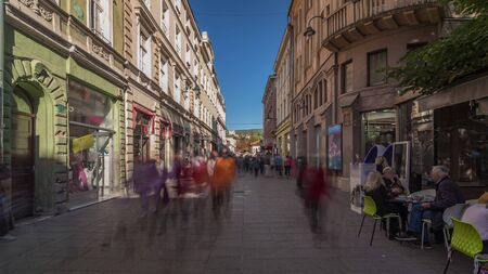 Walk on Ferhadija pedestrian street crowded with people timelapse hyperlapse. Famous place in downtown with many shops and reastaurants in Sarajevo Stock fotó