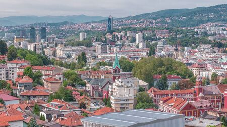 City panorama with cable car moving up and down from Sarajevo station to mountains, Bosnia And Herzegovina . Houses with red roofs Banco de Imagens
