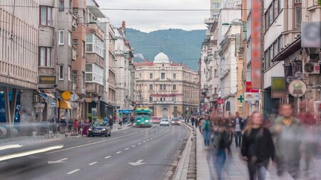 The Eternal flame in the street Ferhadija timelapse is a memorial to the military and civilian victims of the Second World War. Traffic on the road in Sarajevo