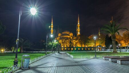 Blue Mosque timelapse hyperlapse at night with golden illumination, Istanbul in dusk. Sultanahmet Camii mosque with six minarets - famous islamic monument of the Ottoman architecture in Turkey. Archivio Fotografico