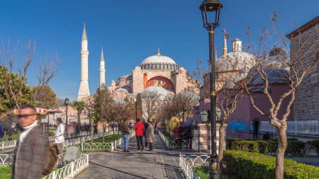 Hagia Sophia timelapse hyperlapse with trees in park, Christian patriarchal basilica, imperial mosque and now a museum, Istanbul, Turkey
