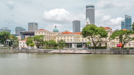 View of Singapore River with Asian Civilisation Museum and old civic district in background timelapse hyperlapse. Clouds on the sky and skyscrapers