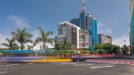 Major road intersection on Plaza Grau square with traffic timelapse hyperlapse in Lima. Skyscrapers on a background Stockfoto