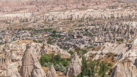 Red Valley and Rose Valley of Goreme of Nevsehir in Cappadocia aerial timelapse, Turkey. Love valley and fairy chimneys panoramic view with historic buildings
