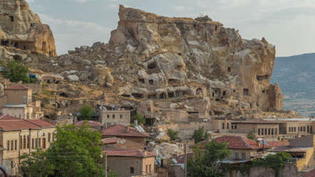 Urgup Town aerial view from Temenni Hill in Cappadocia Region of Turkey timelapse. Old houses and buildings in rocks at early morning