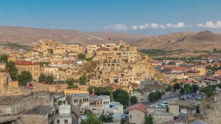 Urgup Town aerial view from Temenni Hill in Cappadocia Region of Turkey timelapse. Old houses and buildings in rocks at evening before sunset