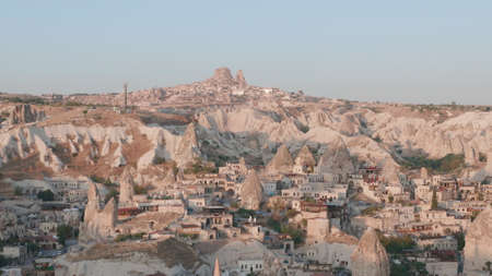 Aerial view from hot air balloon with rocks during Sunrise over the fairytale landscape hills of Kapadokya with morning light. Goreme, Cappadocia, Turkey Archivio Fotografico