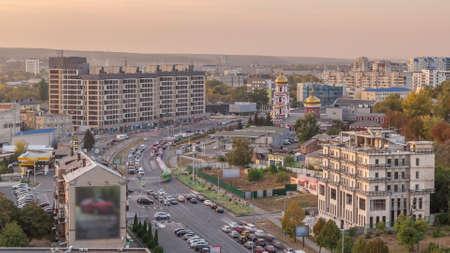 Traffic on the streets of the city aerial timelapse in Kharkov, Ukraine. Klochkovskaya street in the downtown near Shevchenko park before sunset
