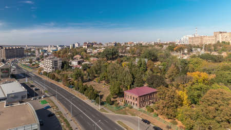 Traffic on the streets of the city aerial timelapse in Kharkov, Ukraine. Klochkovskaya street in the downtown near Shevchenko park. Panoramic cityscape at autumn Archivio Fotografico