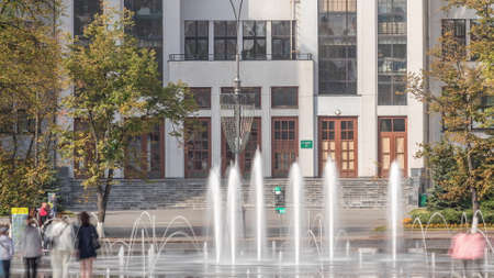 Gosprom building on the Freedom square with new dry fountain with people walking in park in Kharkov city timelapse, Ukraine. Close up view