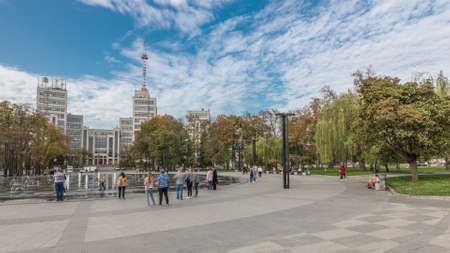 Gosprom building on the Freedom square with new dry fountain with people walking in park in Kharkov city panoramic timelapse, Ukraine