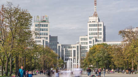 Gosprom building on the Freedom square with new dry fountain with people walking in park in Kharkov city timelapse, Ukraine. Walking area around