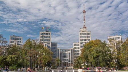 Gosprom building on the Freedom square with new dry fountain with people walking in park in Kharkov city timelapse, Ukraine. Cloudy sky