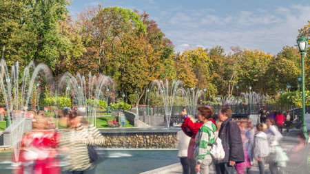 Lake with a fountains in the updated Shevchenko Garden in Kharkov timelapse. People walking around and sitting on benches
