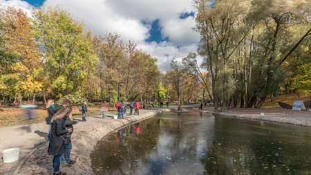 Sarzhin Yar park area with well-equipped mineral spring in Kharkov panoramic timelapse, people fishing on a river which is very popular among the residents of the city. Ukraine