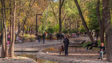 Sarzhin Yar park area with small river in Kharkov timelapse, which is very popular among the residents of the city. People walking and sitting around. Ukraine