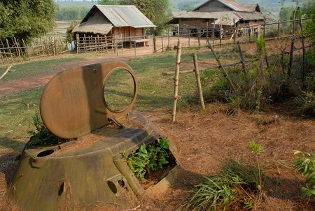 A legacy of the Vietnam war era. Bits of rusty tanks are seen in the Plains of Jars.Old military shells dropped by the USA lay nearby. Stock Photo