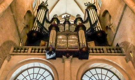 church organ pipes sit at one end of the church interior and surround the oran itself.