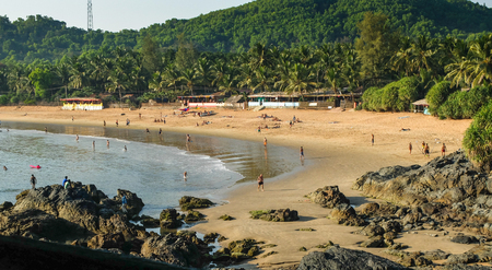 Tourists and travelers enjoying the sun,sea and leisure activities at this increasingly popular beach in India. IIndiauthwestern India.