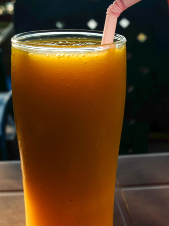 Cold juice served outside in an Indian beach cafe,wth crushed ice.