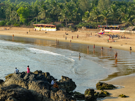 Tourists and travellers enjoying the sun,sea and leisure activities at this increasingly popular beach in India. IIndiauthwestern India. Stock Photo