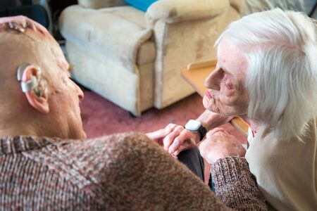 Still in love in their 90's,together,both living and sleeping in the living room downstairs due to their health conditions and looked after by family and carers.
