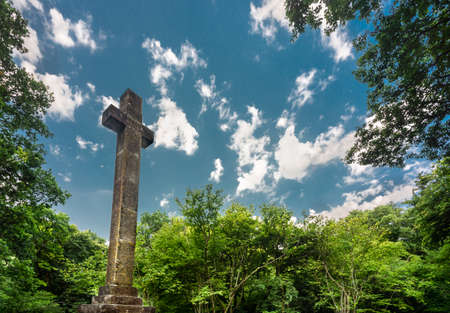 A grade two listed monument,a stone cross erected in 1825 in a clearing of the woods and dedicated to Earl Athelwold of Wherewell who in 963 was killed near the site by his rival in love,King Edgar.