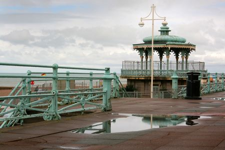 bandstand: Pavilion reflected in puddle on a wet day in Brighton, England, UK Stock Photo