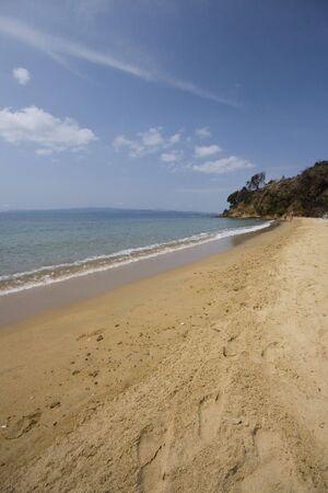 skiathos: Footprints in sand, Skiathos, Greece Stock Photo