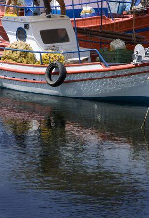 skiathos: Fishing boat reflected, Skiathos, Greece Stock Photo