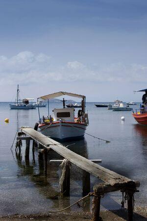 skiathos: Boats tied up on old wooden jetty Skiathos, Greece Stock Photo