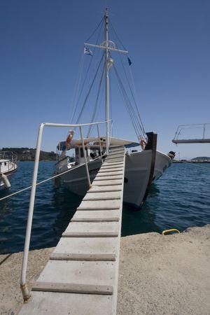 Wooden steps leading onto fishing boat, Skiathos Greece photo