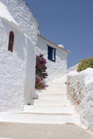 skiathos: Curved path past white walled building Skopolos near island of Skiathos, Greece