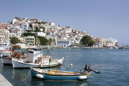 skiathos: Boats lined up in harbor with church in distance, Skopolos near island of Skiathos, Greece