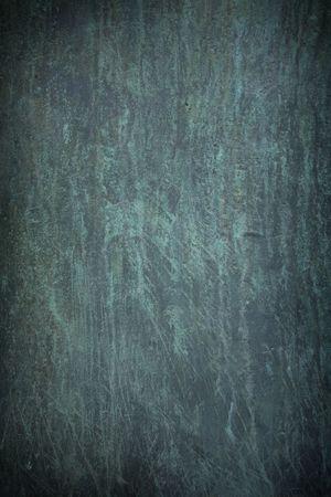 corrode: Dark blue scratch marks on rusty metal background