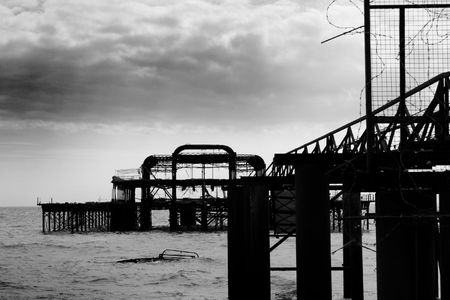 Black and white image of the remains of Brighton West Pier after fire, England, UK photo