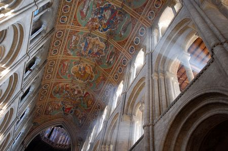 Interior of Ely Cathedral showing ceiling and sunlight streaming through arch, Cambridgeshire, England