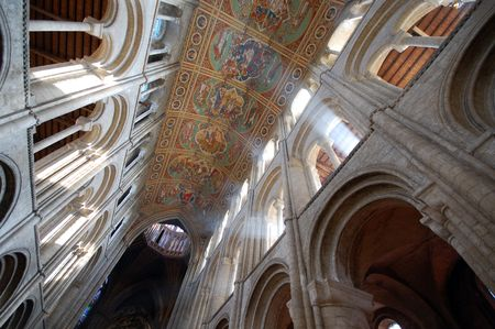 cambridgeshire: Interior of Ely Cathedral showing ceiling and sunlight streaming through arch, Cambridgeshire, England