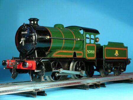 Old vintage metal toy train on rails           写真素材