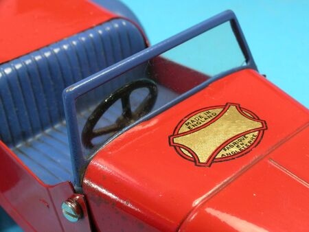 Close up of empty seat in old vintage metal toy car           photo