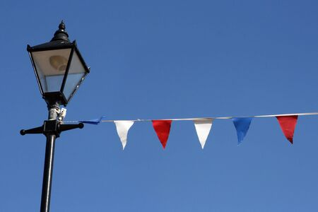 Bunting hanging from streetlight on Broadstairs seafront 写真素材