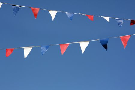 Bunting flags hanging on the seafront, Broadstairs, Kent, England